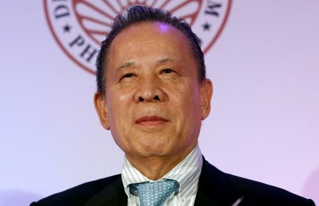 FILE PHOTO: Kazuo Okada, chairman of Tiger Resort, Leisure and Entertainment Inc. listens at the press launch of 65th annual Miss Universe competition