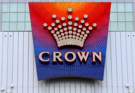 FILE PHOTO - The logo of Australian casino giant Crown Resorts Ltd adorns the hotel and casino complex in Melbourne, Australia