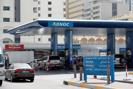 Cars are seen an ADNOC petrol station in Abu Dhabi,