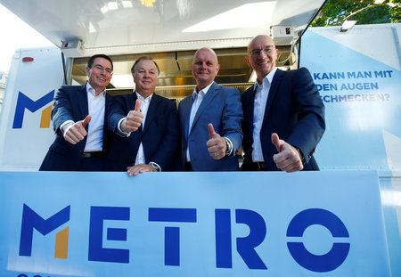 CFO Baier, COO Boone, Chairman of the Board Koch, CHRO Hutmacher of German retailer METRO attend the public offering of their separated food and consumer electronics units in Frankfurt