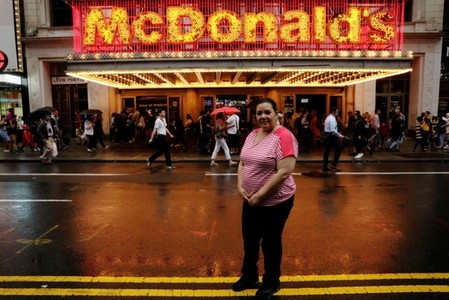 Flavia Cabral, a McDonald's employee, poses for a portrait in New York City