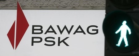 The logo of of U.S.-owned Austrian bank BAWAG PSK is pictured next to traffic lights at a branch office in Vienna