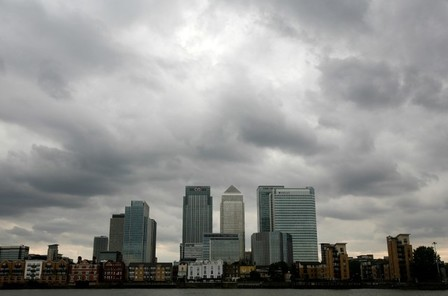 FILE PHOTO: Storm clouds above Canary Wharf financial district in London
