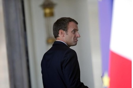 French President Emmanuel Macron reacts at the Elysee Palace in Paris