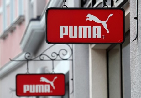 Boards with Puma store logo are seen on a shopping center at the outlet village Belaya Dacha outside Moscow