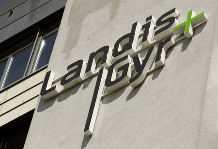 The logo of Swiss-based meter maker Landis+Gyr is seen at an office building in the Swiss town of Zug