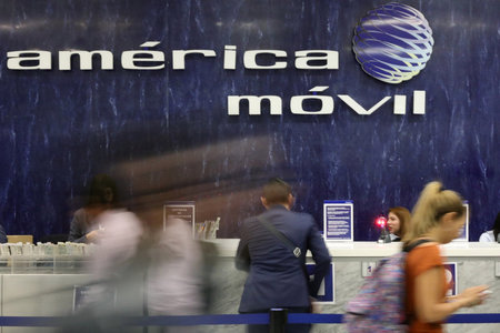FILE PHOTO: The logo of America Movil is pictured on the wall of a reception area in the company's corporate offices in Mexico City