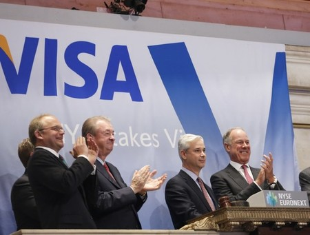 Charles Scharf and company executives ring the opening bell at the New York Stock Exchange