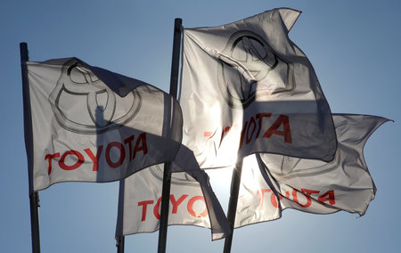 FILE PHOTO - Toyota flags wave at Motorcity Toyota dealership in Rome
