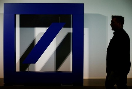 FILE PHOTO: The logo of Deutsche Bank is seen at its headquarters ahead of the bank's annual general meeting in Frankfurt