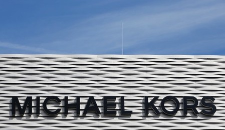 The logo of Michael Kors is seen on an outlet store in Metzingen