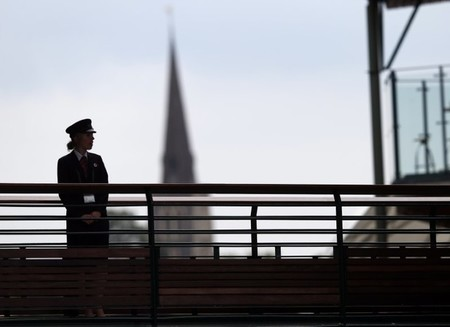 FILE PHOTO - A G4S security guard watches over some of the courts at the Wimbledon Tennis Championships, in London