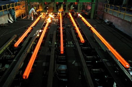 FILE PHOTO: Employees work at a workshop of Hangzhou Iron and Steel Group Company in Hangzhou