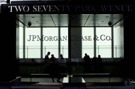 FILE PHOTO: People walk inside JP Morgan headquarters in New York