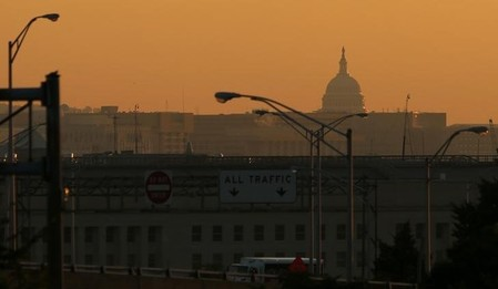 FILE PHOTO: Sunrise over the Capitol on the second day of the government shutdown in Washington
