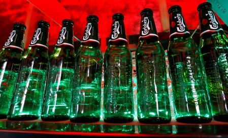 FILE PHOTO: Bottles of Carlsberg beer are seen in a bar in St. Petersburg