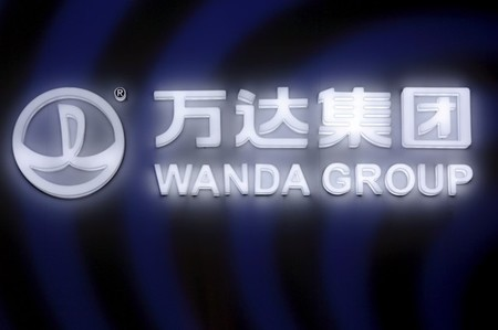 FILE PHOTO: A sign of Dalian Wanda Group in China glows during an event in Beijing