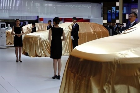 Vehicles seen covered at WEY booth at auto show in Shanghai
