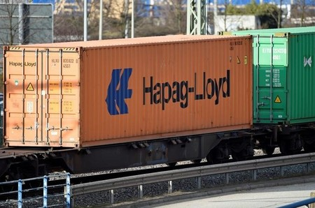 A Hapag Lloyd container is loaded on a train at a shipping terminal in the harbour of Hamburg