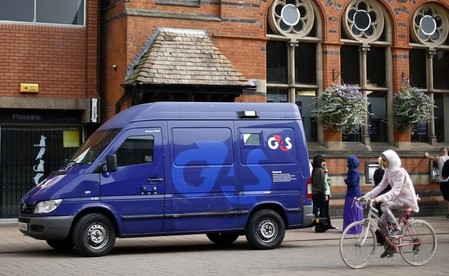 File photo of a G4S security van parked outside a bank in Loughborough