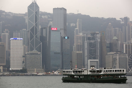 FILE PHOTO - A ferry sails at Victoria Harbour in front of the financial Central district in Hong Kong