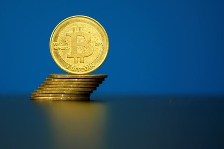 FILE PHOTO -  An illustration photo of Bitcoin (virtual currency) coins are seen at La Maison du Bitcoin in Paris