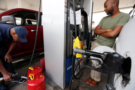 Vehicles line up for gasoline at a service station in the aftermath of Hurricane Harvey, in Dallas