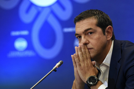 Greek PM Tsipras pauses during a news conference at the annual International Trade Fair of the city of Thessaloniki
