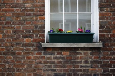 FILE PHOTO - Flowers are seen outside a house in central London