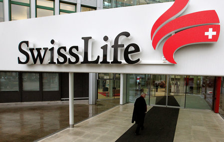 A man walks in front of the entrance of an office of Swiss Life, Switzerland's biggest dedicated life insurer in Zurich
