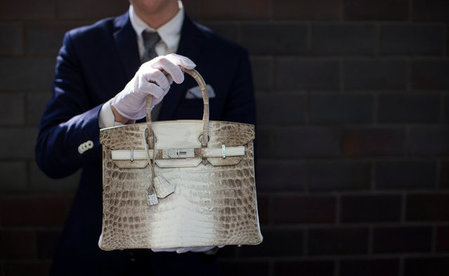FILE PHOTO: An employee holds an Hermes diamond and Himalayan Nilo Crocodile Birkin handbag at Heritage Auctions offices in Beverly Hills