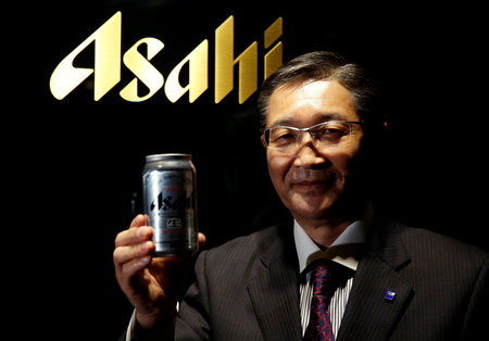 FILE PHOTO : Asahi Group Holdings President and COO Akiyoshi Koji poses for a photo in Tokyo