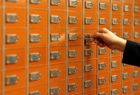 FILE PHOTO - An employee checks a safe box in the vault of a Swiss bank in Basel