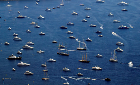 FILE PHOTO: Luxury boats are seen in the bay of Monaco
