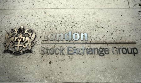 FILE PHOTO - A sign displays the crest and name of the London Stock Exchange in London