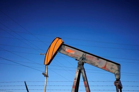 An oil well pump jack is seen at an oil field supply yard near Denver