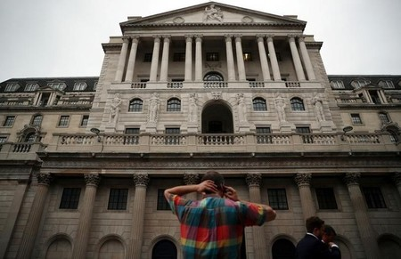 FILE PHOTO - A man speaks on his phone outside the Bank of England in the City of London