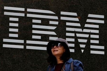 A woman passes by the IBM offices in New York