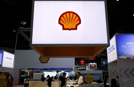 Staff members work at the booth of Royal Dutch Shell at Gastech, the world's biggest expo for the gas industry, in Chiba