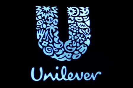 FILE PHOTO:The company logo for Unilever is displayed on a screen on the floor of the NYSE
