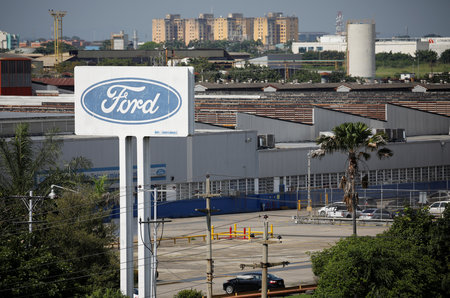 The corporate logo of Ford is seen on a billboard at the facilities of the company in Valencia