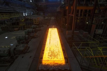 Red-hot slab of metal is processed on a rolling mill at the Novolipetsk steel mill in Lipetsk, Russia