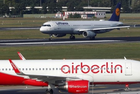 FILE PHOTO - A Lufthansa airliner taxis next to the Air Berlin aircraft at Tegel airport in Berlin