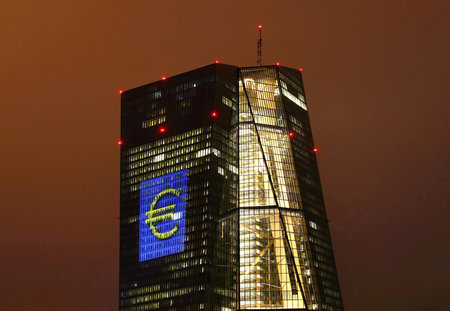 FILE PHOTO: Headquarters of the European Central Bank (ECB) are illuminated with a giant euro sign at the start of the