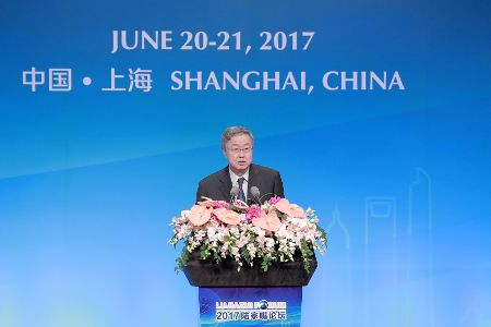 FILE PHOTO: China's central bank governor Zhou Xiaochuan delivers a speech during the annual Lujiazui Forum in Shanghai