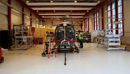 Mechanics prepare prototype of a Marenco SH09 helicopter in a hangar in Mollis