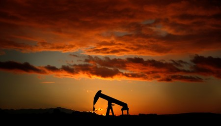 A pump jack is seen at sunset outside Scheibenhard, near Strasbourg