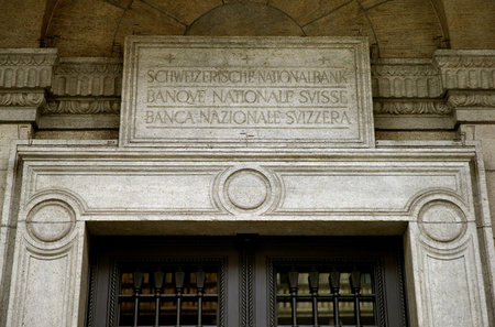 The name of the bank is seen in German, French and Italian language over the entrance of the Swiss National Bank (SNB) in Zurich