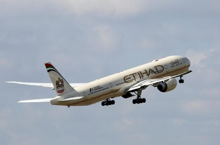 An  Etihad Airways company aircraft takes off at the Charles de Gaulle airport in Roissy