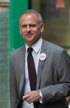 FILE PHOTO: Tesco chief executive Dave Lewis leaves after attending the company's annual general meeting in London